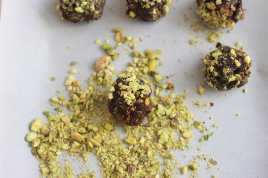 making raw pistachio cherry chocolate snack balls