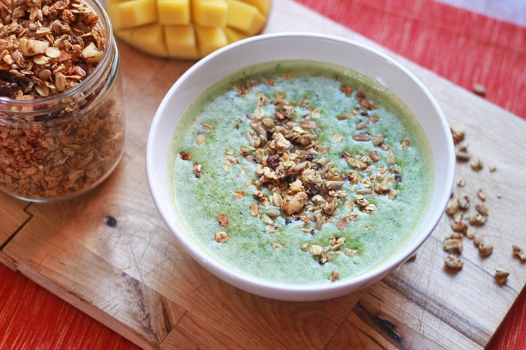 green smoothie bowl with coconut mango granola