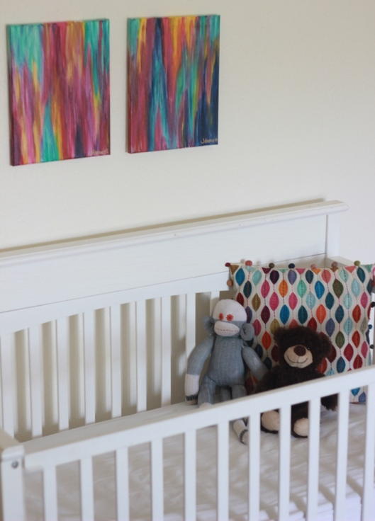 Opal and Eve artwork over crib