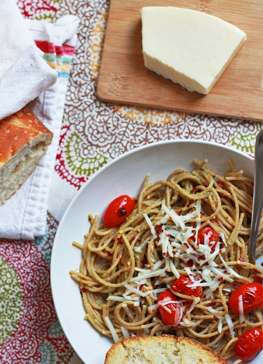 Pasta with basil pesto and blistered tomatoes