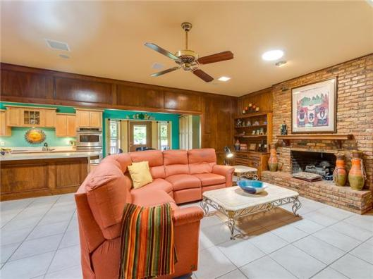 Classic styling in this open floorplan living area. See the kitc